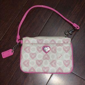 Pink Coach wristlet mini bag